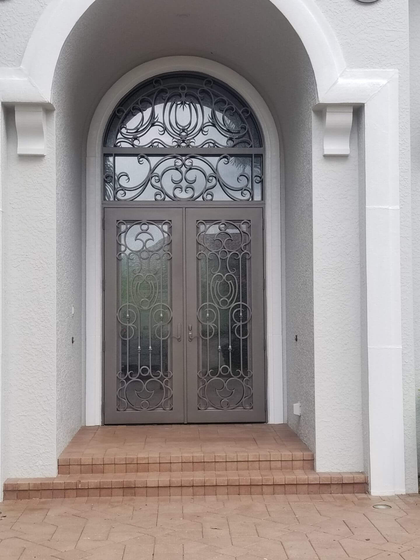 Cantera Door and transoms painted using metallic paint